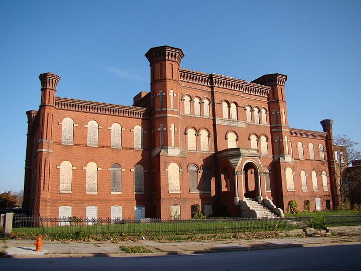 Exterior view of the Hebrew Orphan Asylum with boarded windows