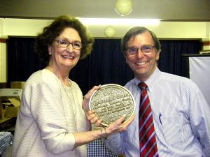 Mary Alice Butts and Councilman James Kraft at a ceremony honoring Ms. Butt's family.