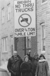 Harry Warren Lowe (far left) and Carol Lowe (far right) with community members under a sign erected from their advocacy. Photo by Carol Martin
