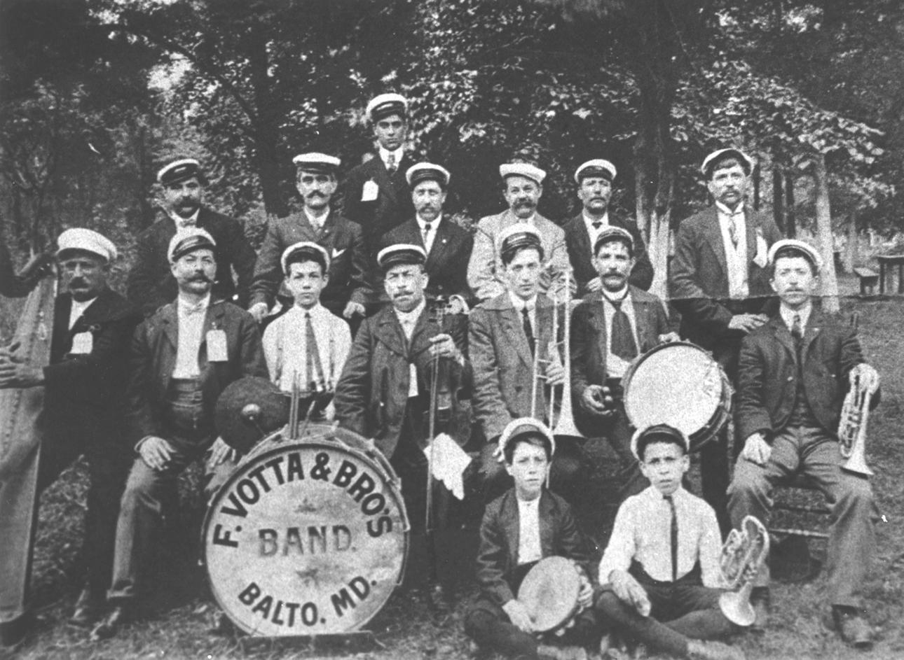 A group picture of the Frank Votta Band, c. 1904-1905. Joseph Pente is seated in the second row, far right holding a trumpet. His younger brother Nicholas is seated on the floor holding a tambourine.