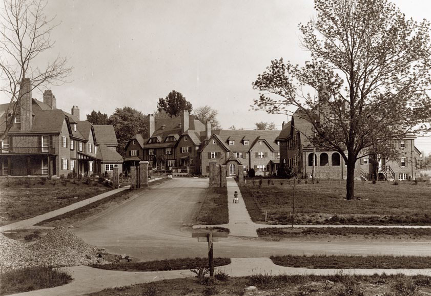 Photograph of Bretton Place, a group of 17 homes in 3 separate structures, designed by Edward Palmer and completed in 1914. Courtesy the Guilford Association.