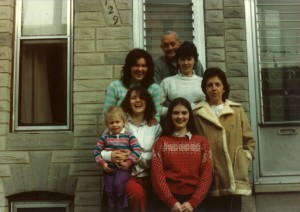 Harry Warren Lowe with daughters and a grandchild in front of 1729 S. Charles Street.