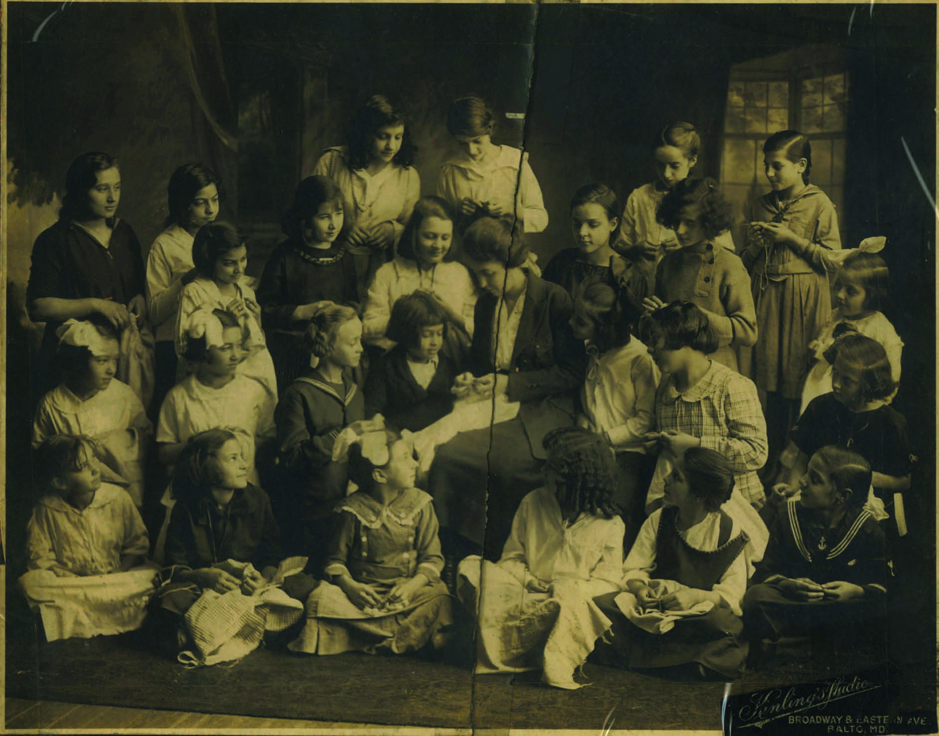 A sewing class of St. Leo's. Rosa, John Pente's sister, is pictured on the bottom row, third from the left.