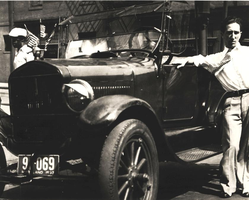 John Pente posing with the Ford Model T he purchased in the 1930s for about twelve dollars.