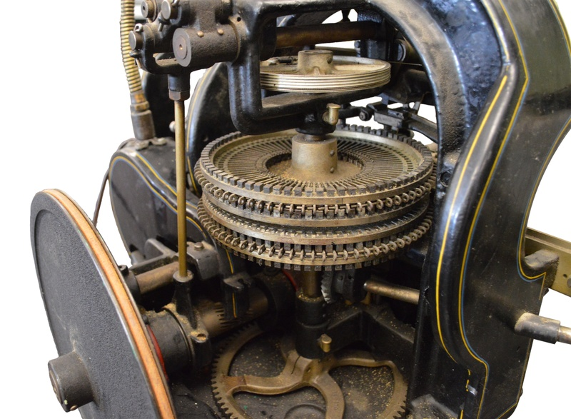 An old mechanical artifacts with a complicated set of gears and wheels.