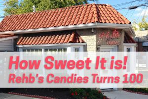 "A small candy store with a tile roof and a neon sign reading: ""Rheb's"" Overlaid pink text reads: ""How Sweet It Is! Rehb's Candies Turns 100"""