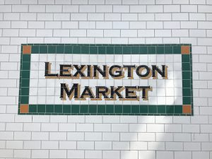 Mosaic sign reading Lexington Market